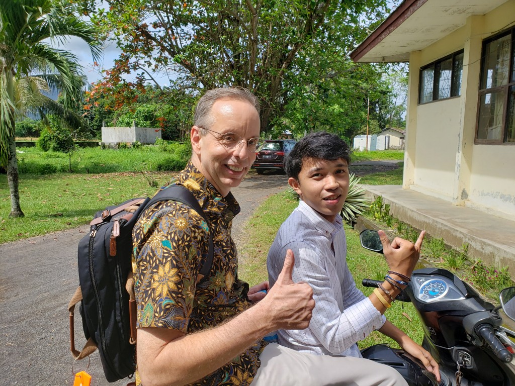 Ron Betzig with ecotourism student Satriya on his -rescue- motor bike